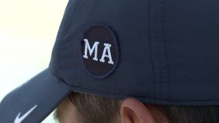 Cal men's golf team sports honorary hat patch at Championships